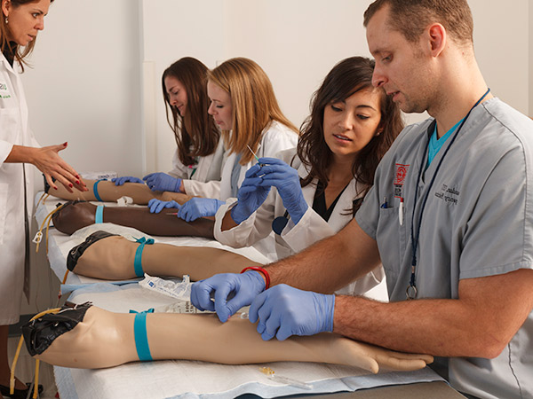 Health care professionals learning new medical techniques