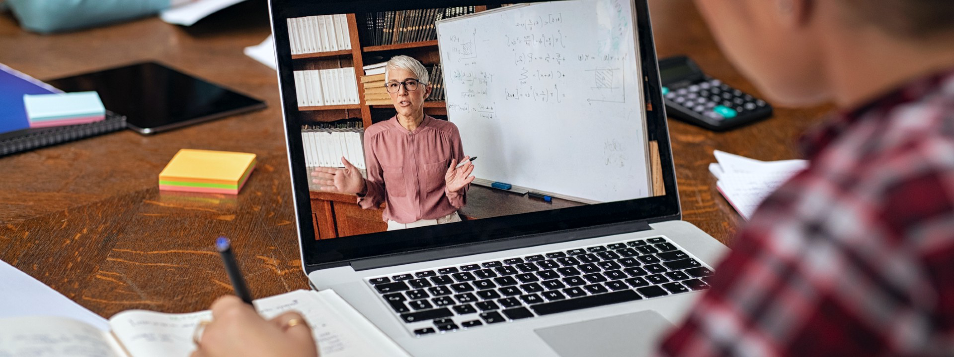 Laptop showing professor giving remote lecture
